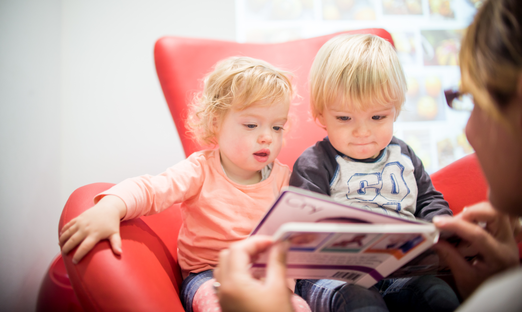 Young children being read to