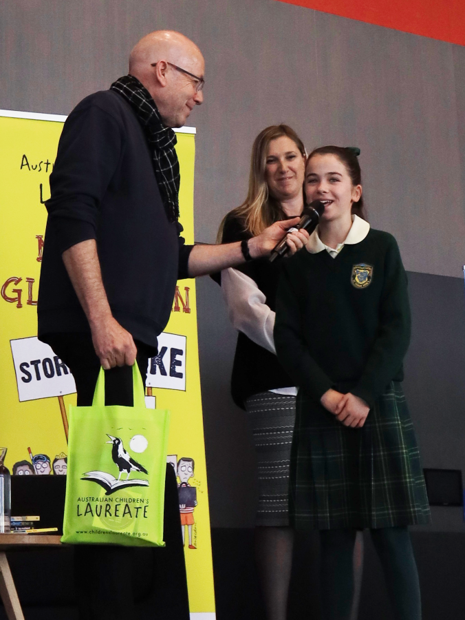 Morris Gleitzman with northern grade 6 winner Bridgid from St Thomas Mores Primary School.png